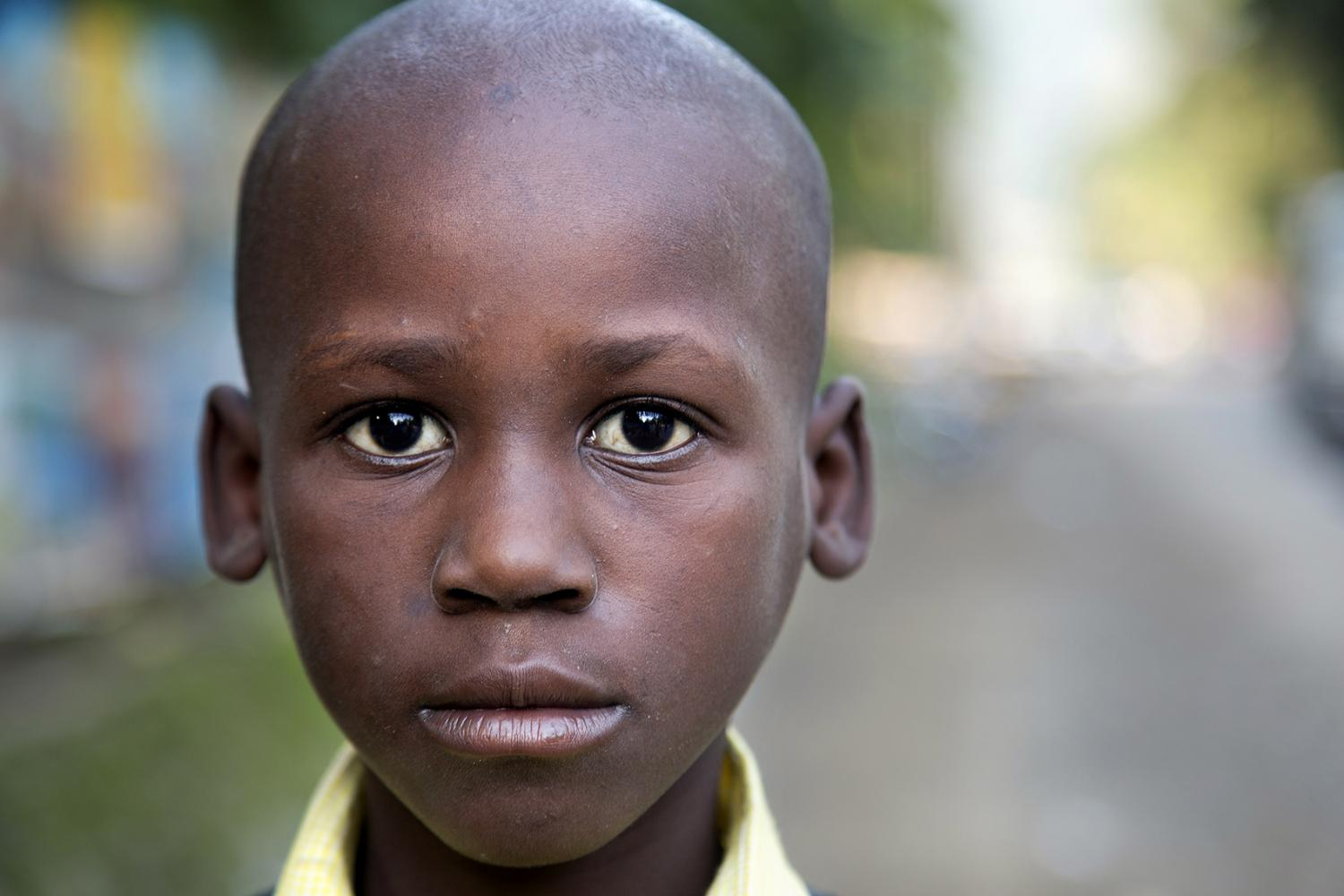 A boy on his way home from school in Milot, Haiti.