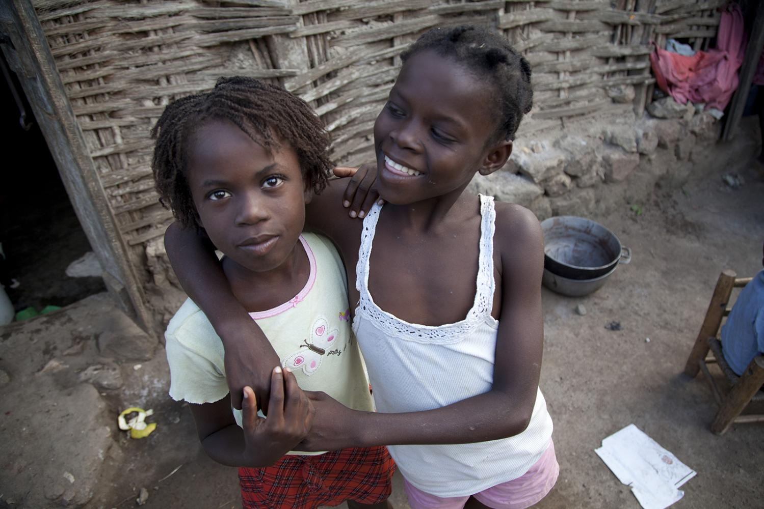 Sisters together at their house in Milot, Haiti.
